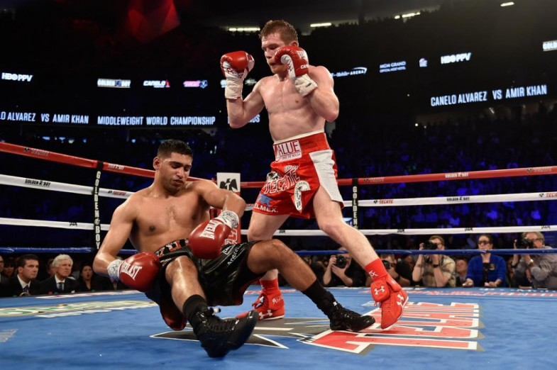 LAS VEGAS, NEVADA - MAY 07: Canelo Alvarez (R) knocks out Amir Khan during the WBC middleweight title fight at T-Mobile Arena on May 7, 2016 in Las Vegas, Nevada. (Photo by David Becker/Getty Images)