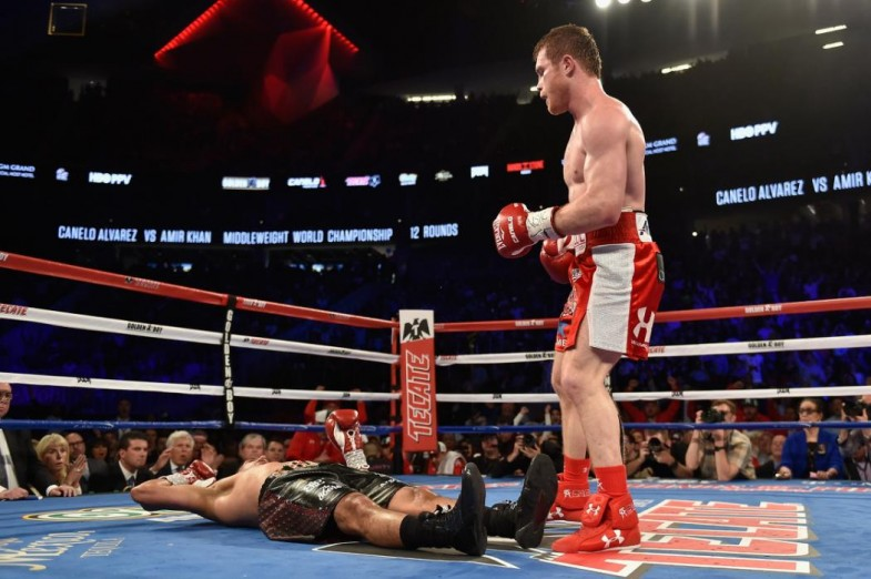 LAS VEGAS, NEVADA - MAY 07: Canelo Alvarez (R) reacts after his knockout to Amir Khan during the WBC middleweight title fight at T-Mobile Arena on May 7, 2016 in Las Vegas, Nevada. (Photo by David Becker/Getty Images)