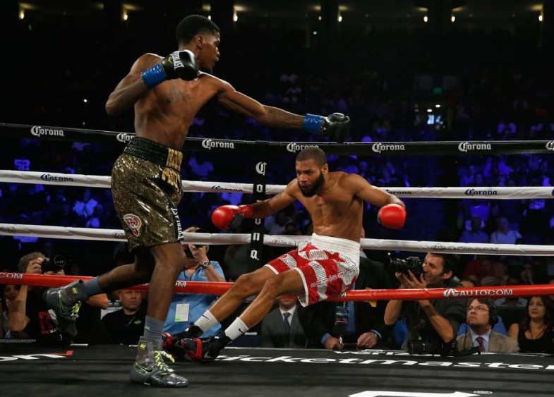 OAKLAND, CA - AUGUST 06: Maurice Hooker (left) fights Tyrone Barnett in their NABO Junior Welterweight Title bout at ORACLE Arena on August 6, 2016 in Oakland, California. (Photo by Lachlan Cunningham/Getty Images)