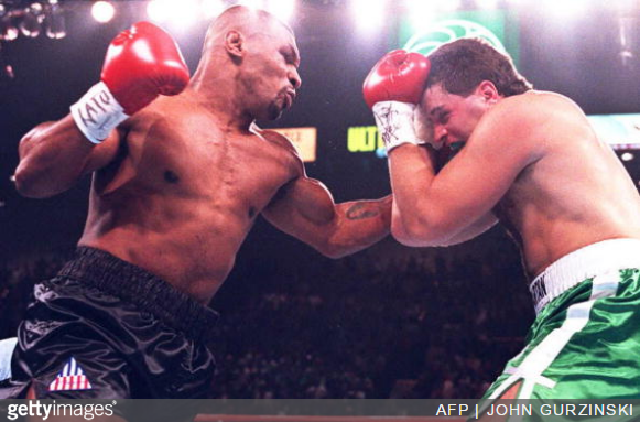 Mike Tyson Peter McNeeley - Getty Images