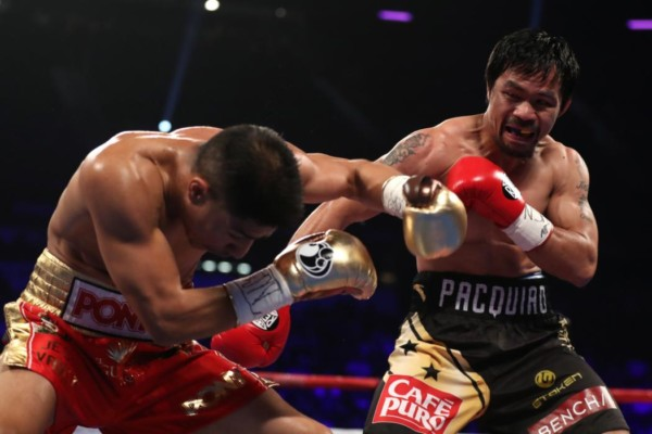 LAS VEGAS, NV - NOVEMBER 05:   (R-L) Manny Pacquiao of the Philippines and Jessie Vargas trade punches during their WBO welterweight championship fight at the Thomas & Mack Center on November 5, 2016 in Las Vegas, Nevada. (Photo by Christian Petersen/Getty Images)
