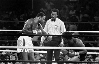 larry-holmes-leon-spinks-getty-images