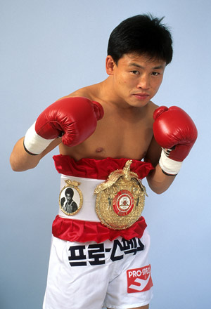 ATLANTIC CITY - FEBRUARY 2,1991: Myung Woo Yuh poses with his belt for a portrait in Atlantic City, New Jersey. (Photo by: The Ring Magazine/Getty Images)