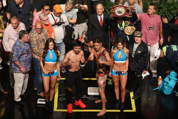 LAS VEGAS, NV - NOVEMBER 04: Manny Pacquiao (L) and WBO welterweight champion Jessie Vargas pose during their official weigh-in at the Encore Theater at Wynn Las Vegas on November 4, 2016 in Las Vegas, Nevada. Vargas will defend his title against Pacquiao on November 5 at the Thomas & Mack Center in Las Vegas. (Photo by Christian Petersen/Getty Images)